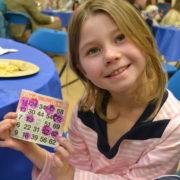 bingo night student with card