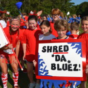 red team displays sign during field day
