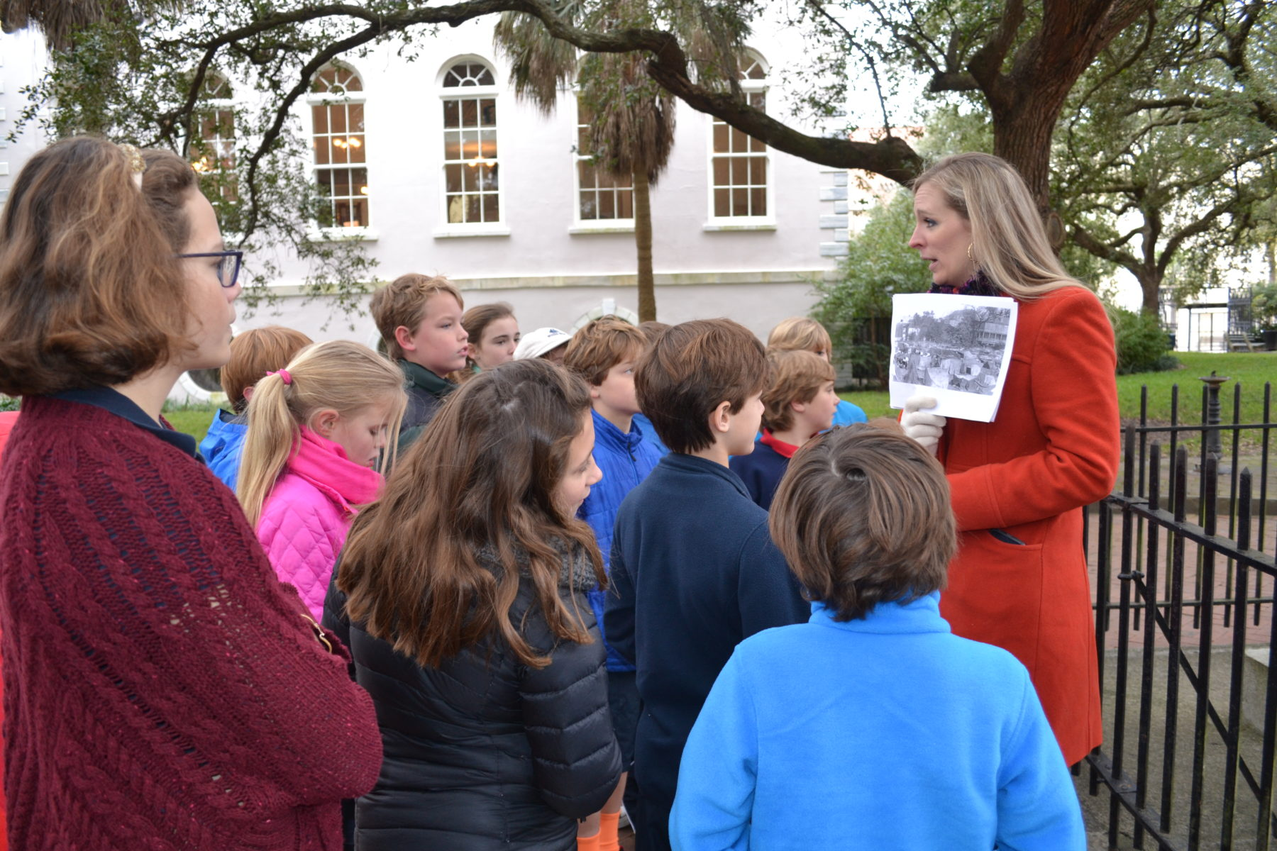 teacher instructs students during charleston history field trip