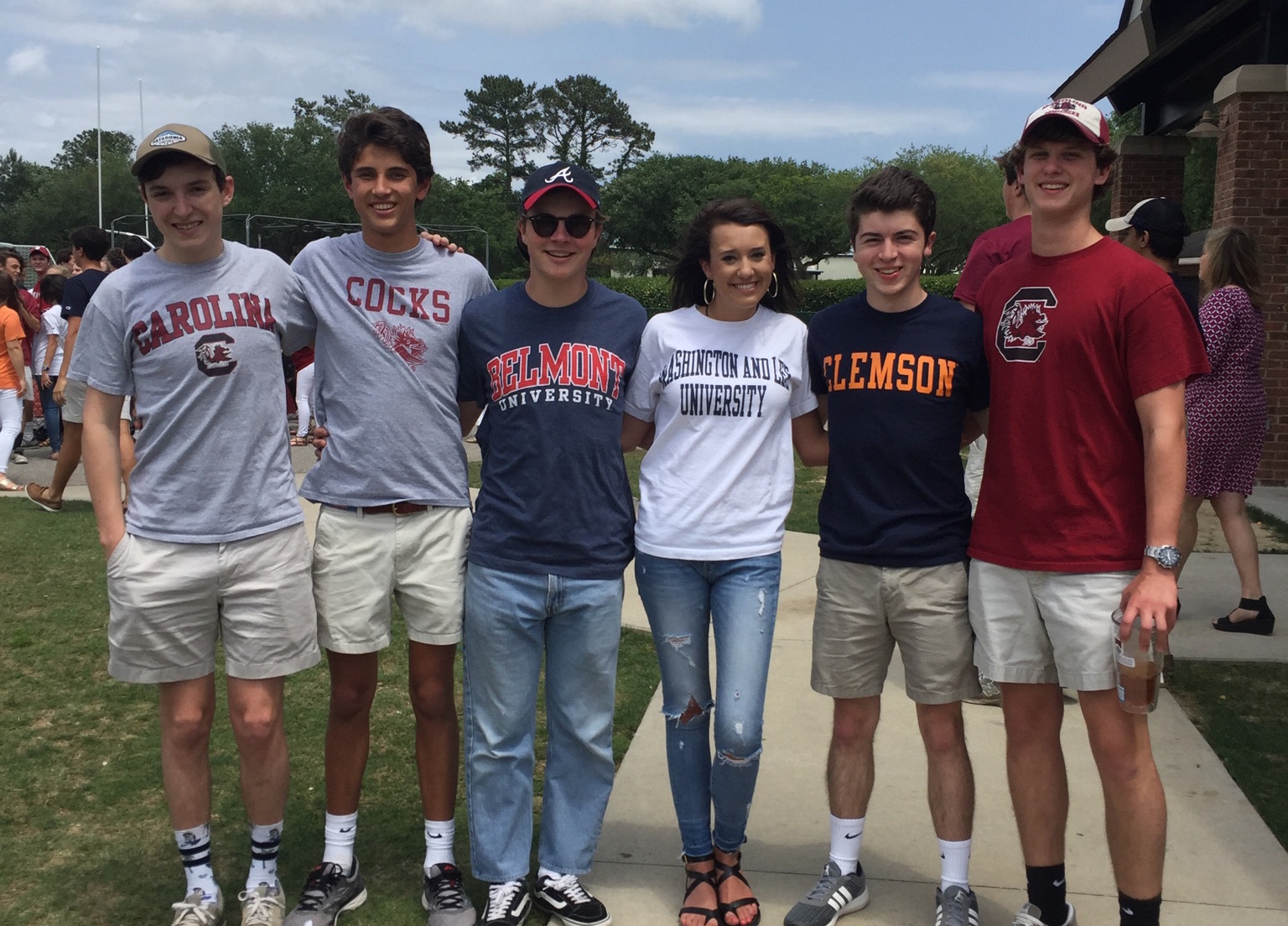 porter gaud students pose in their college shirts