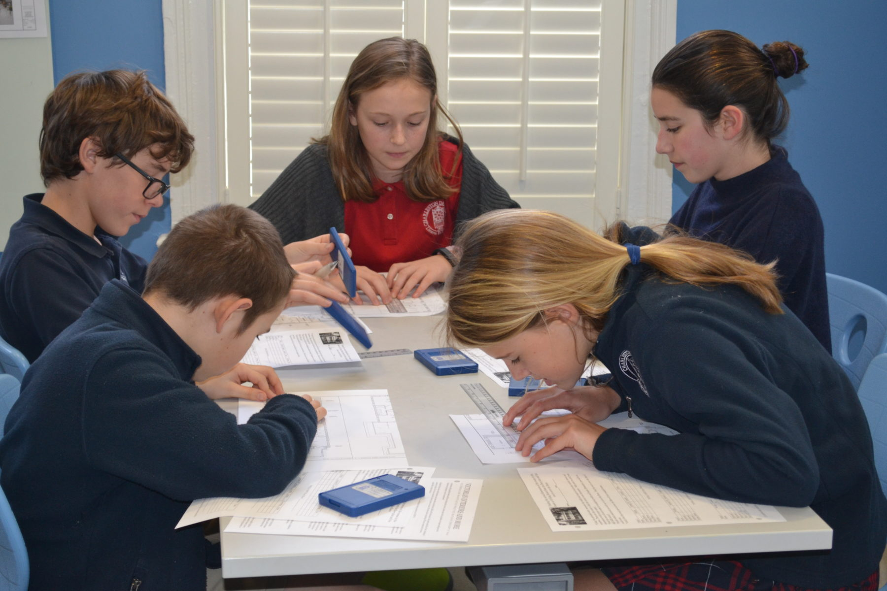 students work around table in moore house