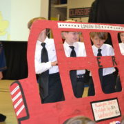 2nd graders perform on bus around the world