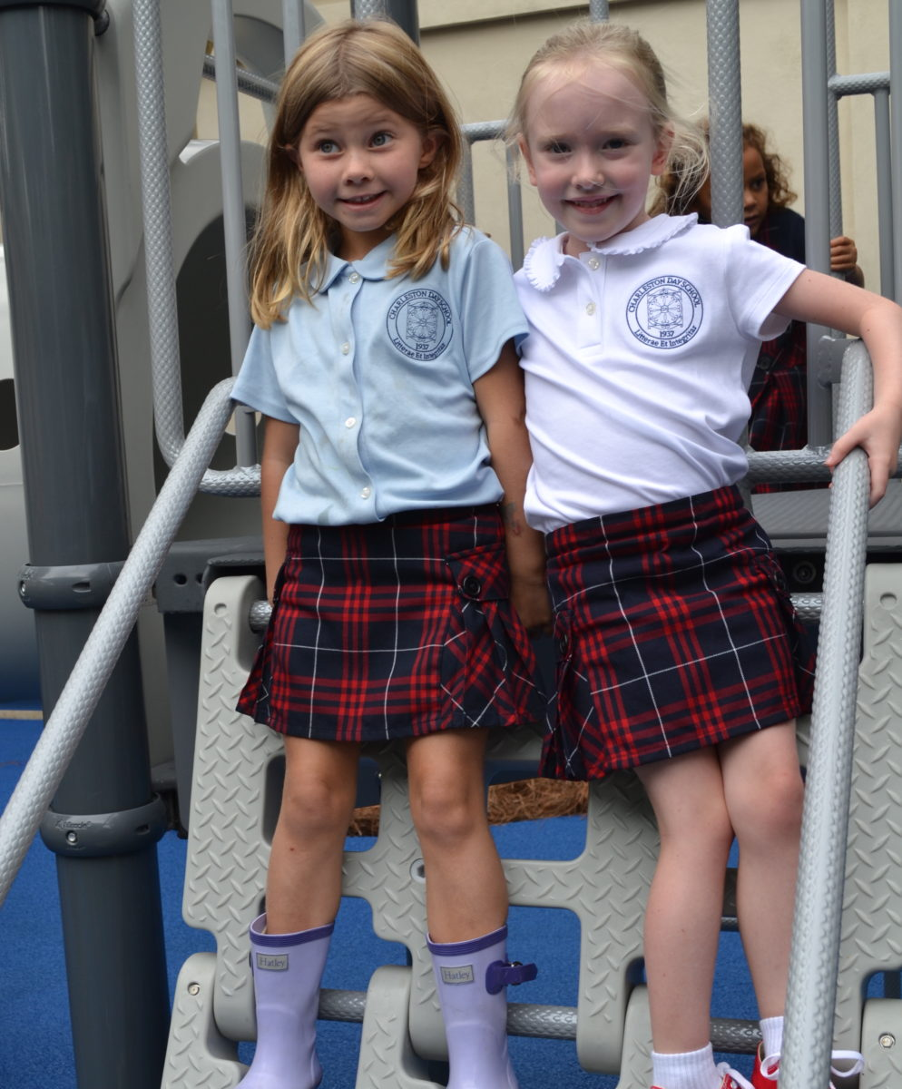 kindergarten girls play on play structure